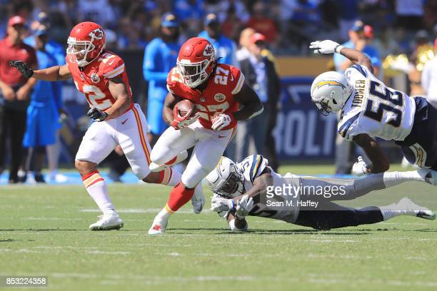 Kareem Hunt of the Kansas City Chiefs avoids the tackle against Jatavis Brown of the Los Angeles Chargersduring the game against the Los Angeles...