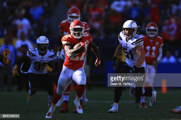 Kareem Hunt of the Kansas City Chiefs for a touchdown as Kyle Emanuel of the Los Angeles Chargers chases during the second half of a game at StubHub...