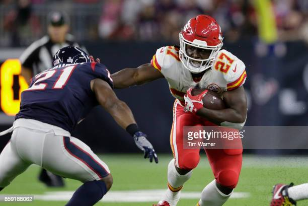 Kareem Hunt of the Kansas City Chiefs gives a stiff arm to Marcus Gilchrist of the Houston Texans in the third quarter at NRG Stadium on October 8...