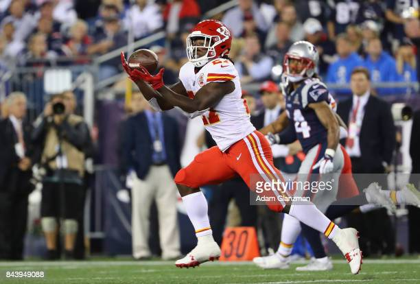 Kareem Hunt of the Kansas City Chiefs makes a 78yard touchdown reception during the fourth quarter against the New England Patriots at Gillette...