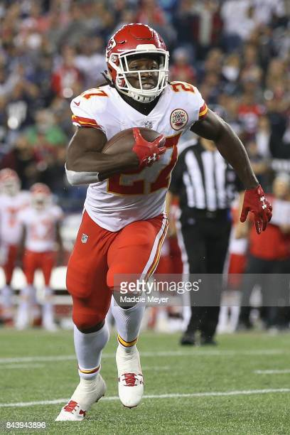 Kareem Hunt of the Kansas City Chiefs runs for a 4yard rushing touchdown during the fourth quarter against the New England Patriots at Gillette...