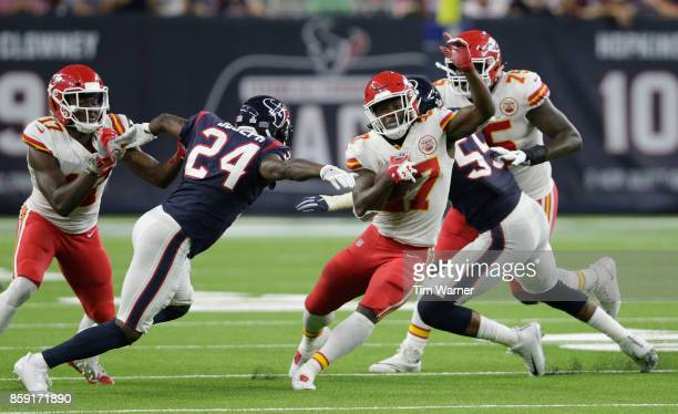 Kareem Hunt of the Kansas City Chiefs runs the ball defended by Johnathan Joseph of the Houston Texans in the third quarter at NRG Stadium on October...
