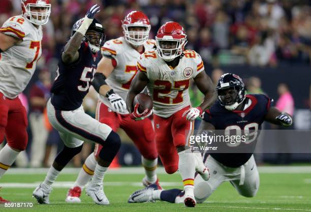 Kareem Hunt of the Kansas City Chiefs runs the ball past DJ Reader of the Houston Texans and Benardrick McKinney in the second quarter at NRG Stadium...