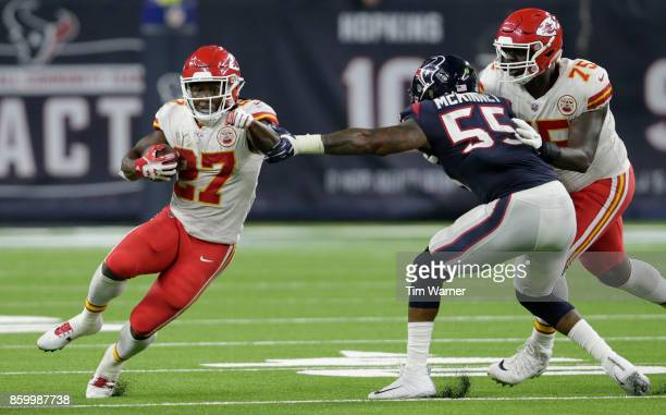 Kareem Hunt of the Kansas City Chiefs runs through the grasp of Benardrick McKinney of the Houston Texans in the second quarter at NRG Stadium on...