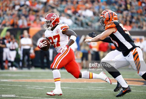 Kareem Hunt of the Kansas City Chiefs runs with the ball against the Cincinnati Bengals during the preseason game at Paul Brown Stadium on August 19...