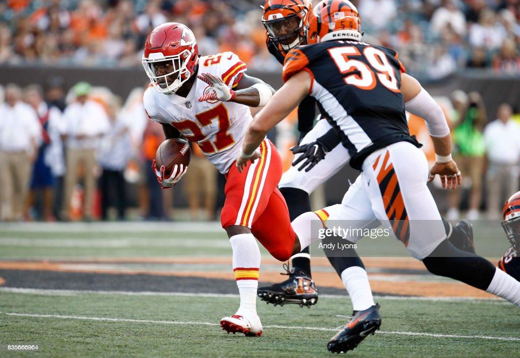 Kareem Hunt #27 of the Kansas City Chiefs runs with the ball against the Cincinnati Bengals during the preseason game at Paul Brown Stadium on August 19, 2017 in Cincinnati, Ohio.