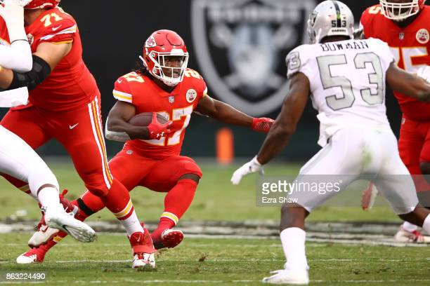Kareem Hunt of the Kansas City Chiefs rushes against the Oakland Raiders during their NFL game at OaklandAlameda County Coliseum on October 19 2017...