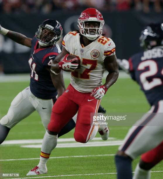 Kareem Hunt of the Kansas City Chiefs rushes with the ball against the Houston Texans in the second quarter at NRG Stadium on October 8 2017 in...