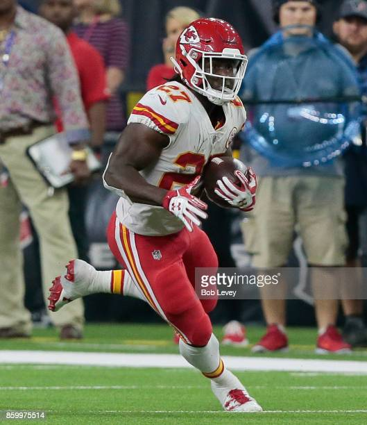 Kareem Hunt of the Kansas City Chiefs rushes with the ball against the Houston Texans in the second half at NRG Stadium on October 8 2017 in Houston...