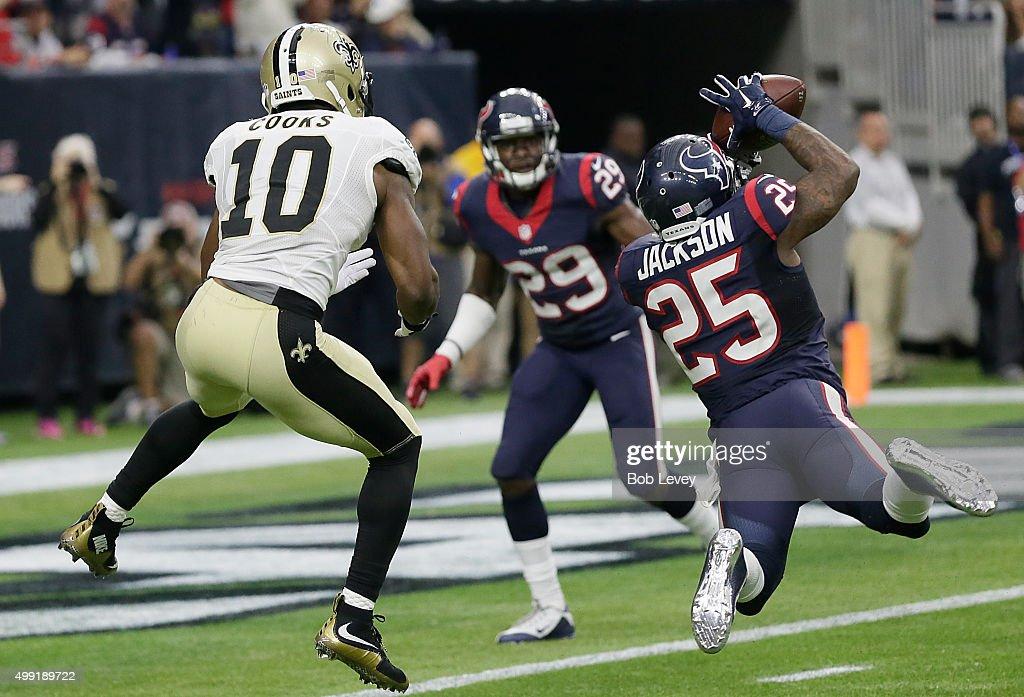 Kareem Jackson of the Houston Texans intercepts the ball against Brandin Cooks of the New Orleans Saints in the fourth quarter on November 29 2015 at...