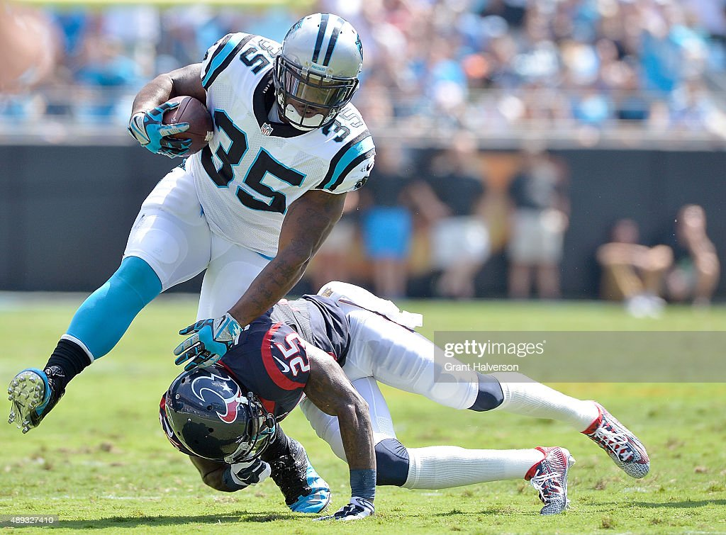 Kareem Jackson of the Houston Texans upends Mike Tolbert of the Carolina Panthers during their game at Bank of America Stadium on September 20 2015...