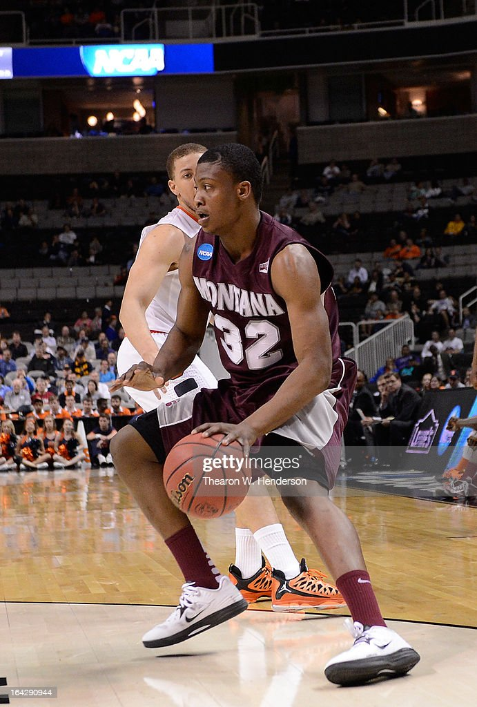 Kareem Jamar #32 of the Montana Grizzlies drives on <a gi-track='captionPersonalityLinkClicked' href=/galleries/search?phrase=Brandon+Triche&family=editorial&specificpeople=6516120 ng-click='$event.stopPropagation()'>Brandon Triche</a> #20 of the Syracuse Orange in the second half during the second round of the 2013 NCAA Men's Basketball Tournament at HP Pavilion on March 21, 2013 in San Jose, California.