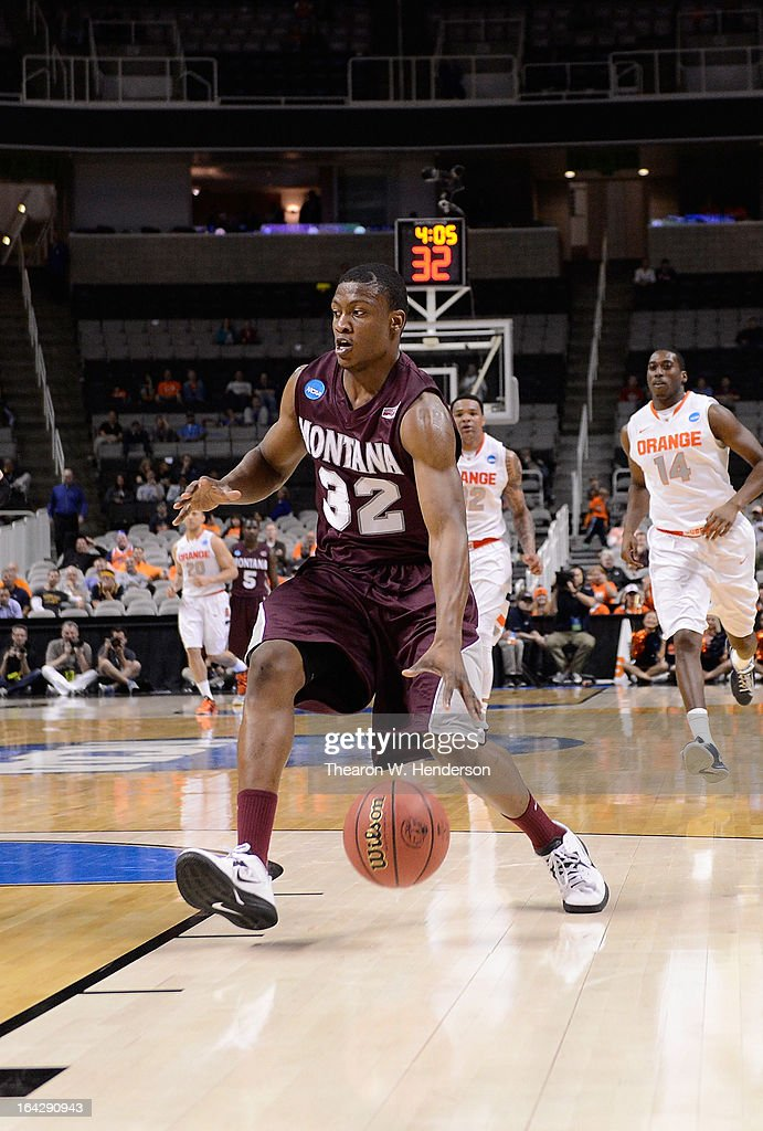Kareem Jamar #32 of the Montana Grizzlies drives to the basket against the Syracuse Orange in the second half during the second round of the 2013 NCAA Men's Basketball Tournament at HP Pavilion on March 21, 2013 in San Jose, California.
