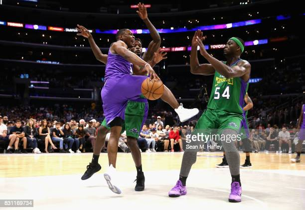bf8fe346479 ... Nike Color Rush uniforms Kareem Rush and Kwame Brown of 3 Headed  Monsters defend against Marcus Banks of Ghost Killers ...