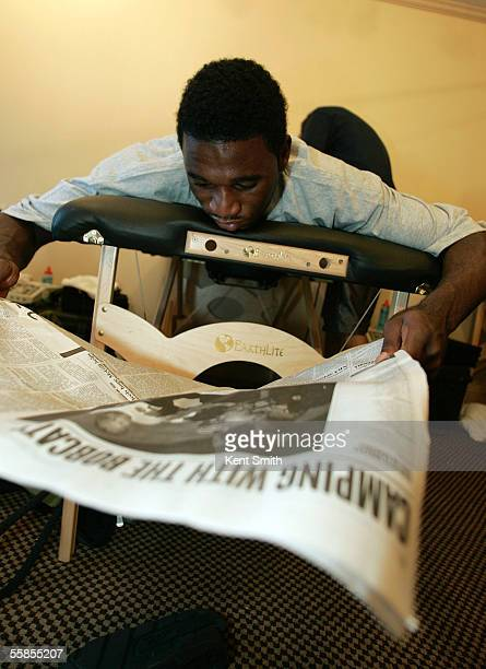 Kareem Rush of the Charlotte Bobcats reads the morning newspaper with a headline that says 'Camping With the Bobcats' during Bobcats Training Camp...