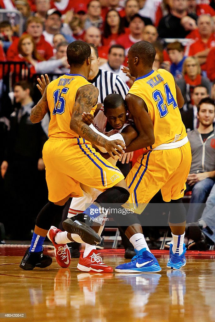 Kareem Storey of the Morehead State Eagles and Marquel Willis of the Morehead State Eagles collapse to keep Shannon Scott of the Ohio State Buckeyes...