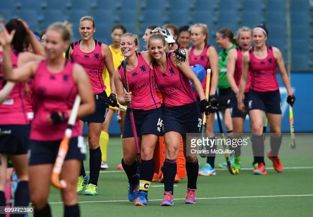 Kareena Cuthbert and Robyn Collins of Scotland hug one another after holding on for a draw against China during the FINTRO Women's Hockey World...