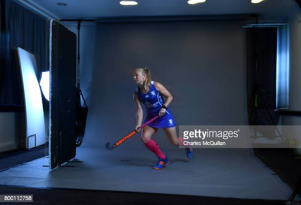 Kareena Cuthbert of Scotland runs across the studio floor during a player portrait photo session for FINTRO Hockey World League on June 23 2017 in...