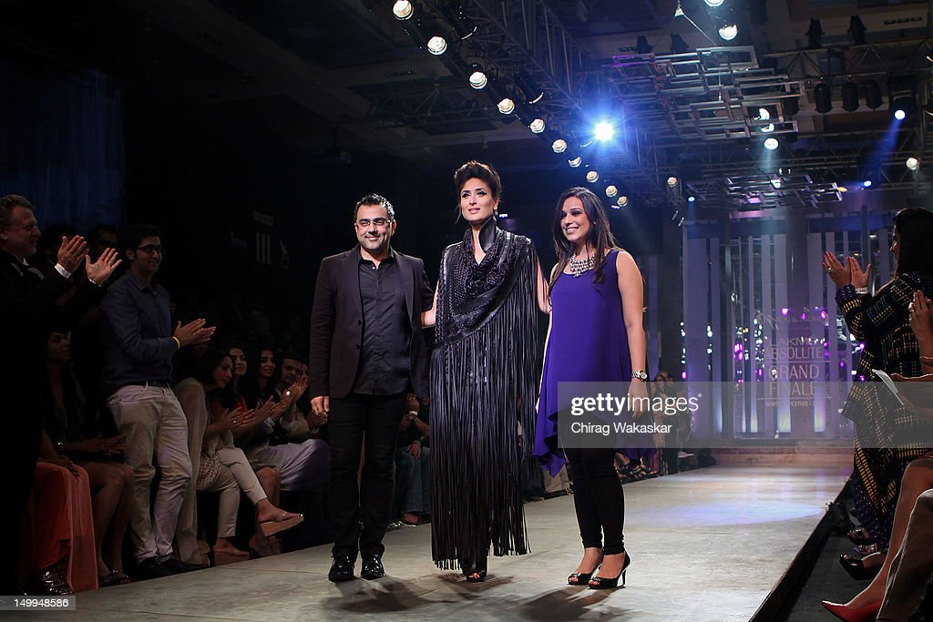 <a gi-track='captionPersonalityLinkClicked' href=/galleries/search?phrase=Kareena+Kapoor&family=editorial&specificpeople=855270 ng-click='$event.stopPropagation()'>Kareena Kapoor</a> (C) walks the runway with designers Pankaj Ahuja (L) & Nidhi Ahuja (R) at The Grand Finale of The Lakme Fashion Week Winter/Festive 2012 day 5 at the Grand Hyatt on August 7, 2012 in Mumbai, India.