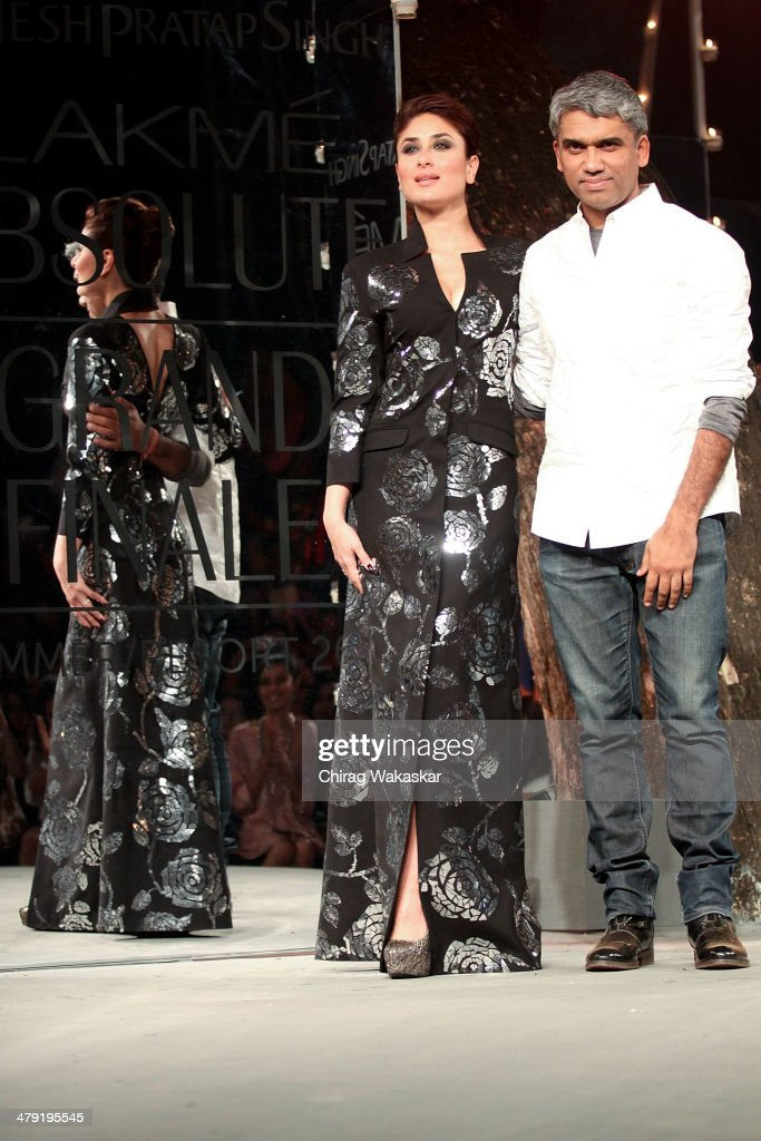 <a gi-track='captionPersonalityLinkClicked' href=/galleries/search?phrase=Kareena+Kapoor&family=editorial&specificpeople=855270 ng-click='$event.stopPropagation()'>Kareena Kapoor</a> (L) walks the runway with Rajesh Pratap Singh (R) at the Grand Finale of Lakme Fashion Week Summer/Resort 2014 at the Grand Hyatt on March 16, 2014 in Mumbai, India.