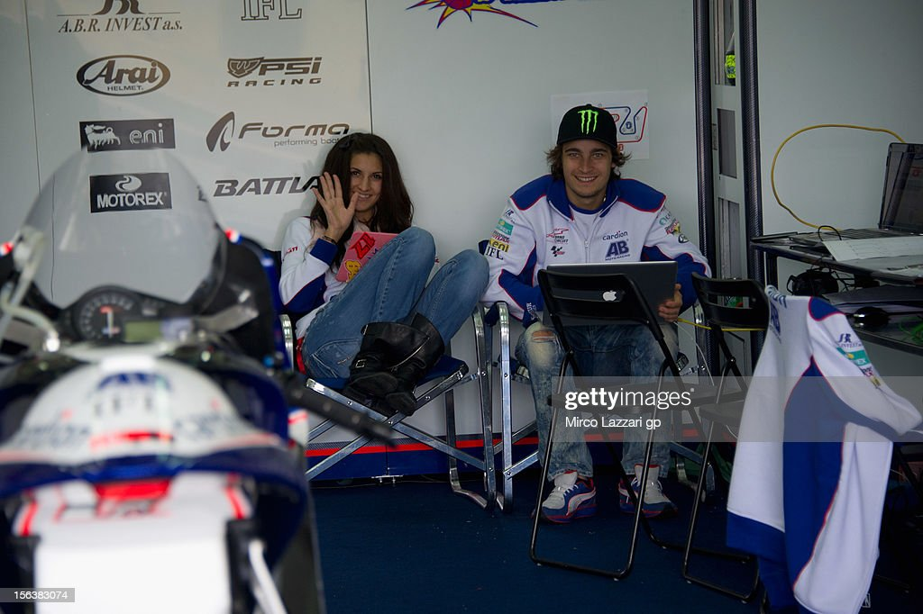 Karel Abraham of Czech and Cardion AB Motoracing works at computer in box with his girlfriend during the second day of pre season MotoGP testing at Ricardo Tormo Circuit on November 14, 2012 in Valencia, Spain.