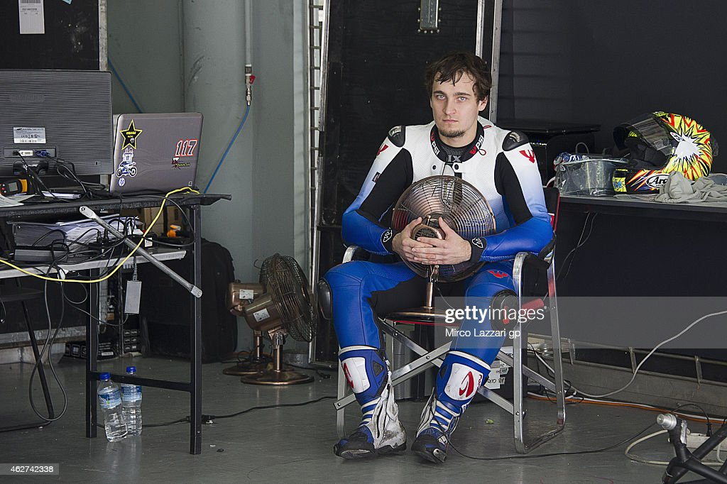 Karel Abraham of Czech Republic and AB Motoracing uses a fan to cool himself in the box during day one of the MotoGP tests at Sepang Circuit on February 4, 2015 in Kuala Lumpur, Malaysia.