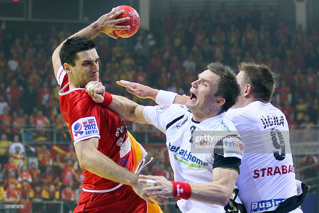 Karel Nocar of Czech Republic (C) defends against <a gi-track='captionPersonalityLinkClicked' href=/galleries/search?phrase=Kiril+Lazarov&family=editorial&specificpeople=3239733 ng-click='$event.stopPropagation()'>Kiril Lazarov</a> of Macedonia (L) during the Men's European Handball Championship group B match between Czech Republic and Macedonia at Cair Sports Centre on January 19, 2011 in Nis, Serbia.