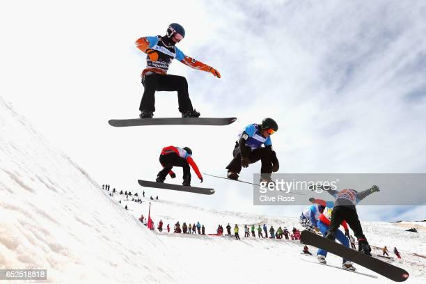 Karel van Goor of Netherlands and Adam Lambert of Australia compete in the Men's Snowboard Cross quarter final 3 on day five of the FIS Freestyle Ski...