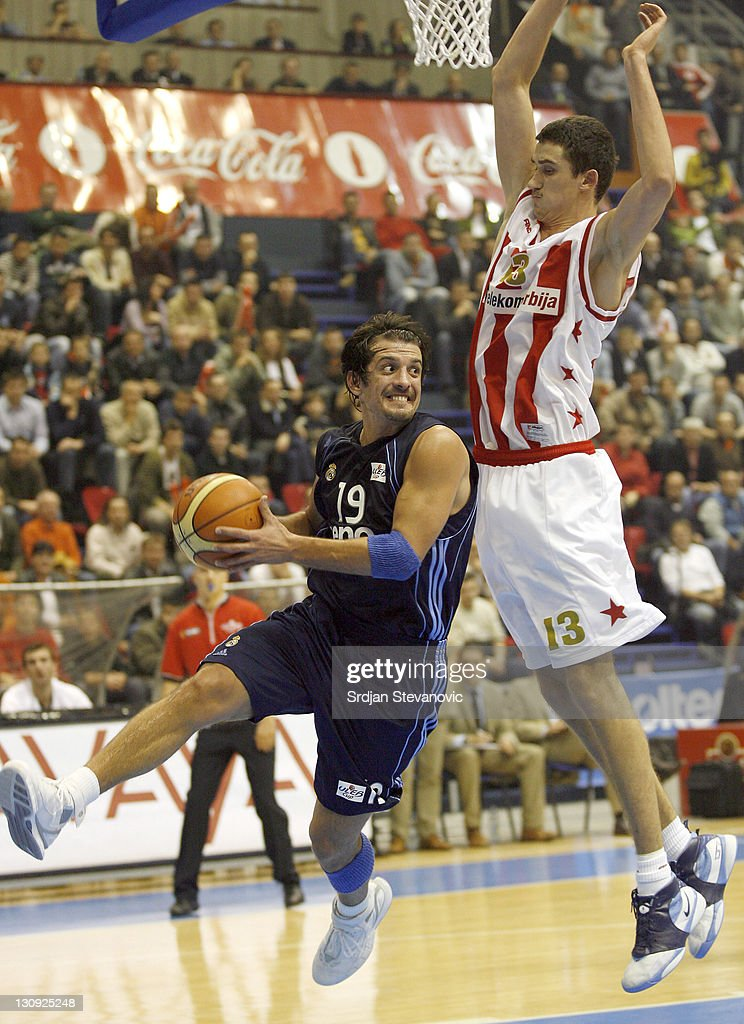 Karem Tunceri of Real Madrid is challenged by Nenad Misanovic of Red Star Belgrade during their group D ULEB Cup basketball match in Belgrade Serbia...