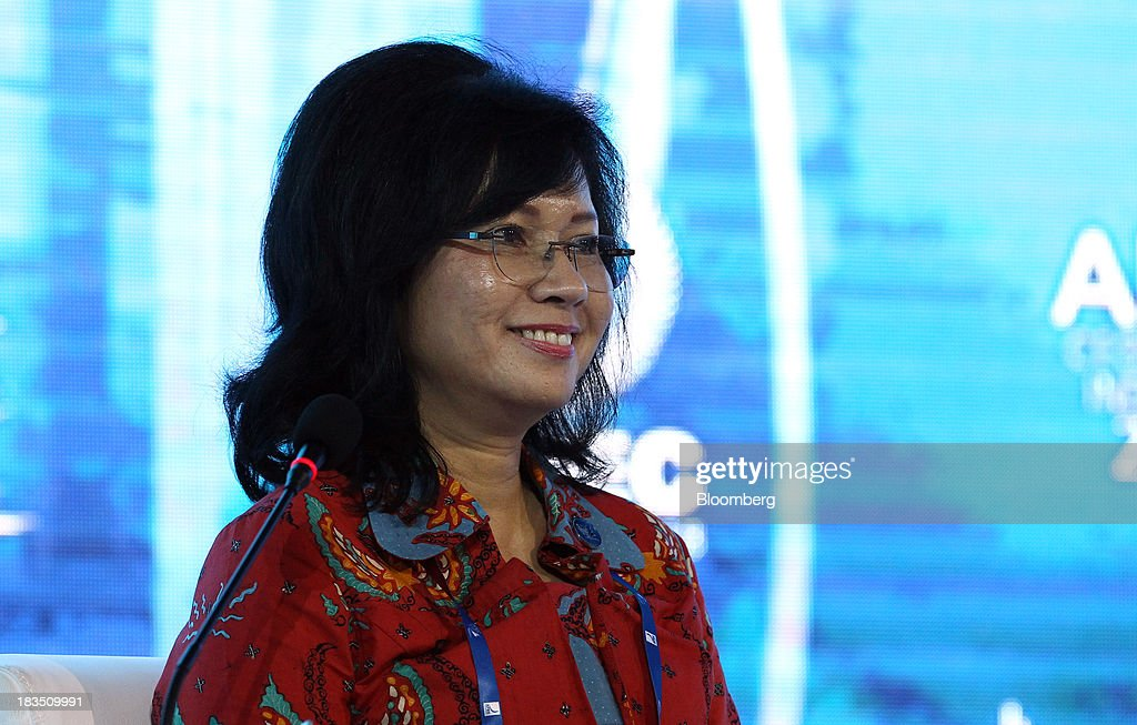 Karen Agustiawan, president director and chief executive officer of PT Pertamina, reacts during a panel discussion at the Asia-Pacific Economic Cooperation (APEC) CEO Summit in Nusa Dua, Bali, Indonesia, on Monday, Oct. 7, 2013. Asia-Pacific governments are calling for vigilance against protectionism as economic growth slows in parts of the region and completion of a 12-nation trade accord looks set to be delayed further. Photographer: SeongJoon Cho/Bloomberg via Getty Images
