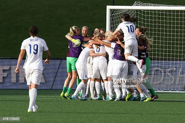 Karen Bardsley and Karen Carney of England celebrate their team's win with team mates after the FIFA Women's World Cup Canada 2015 round of 16 match...