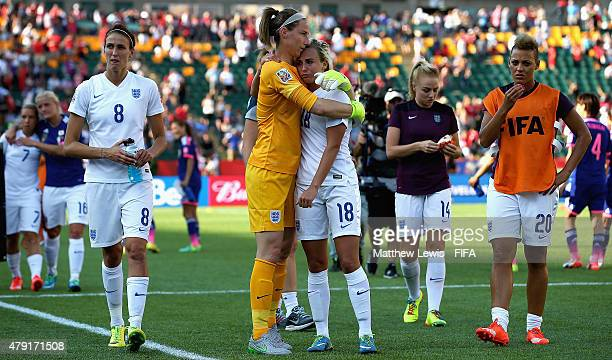 Karen Bardsley consoles Toni Duggan of England after they lost to Japan during the FIFA Women's World Cup 2015 Semi Final match between Japan and...