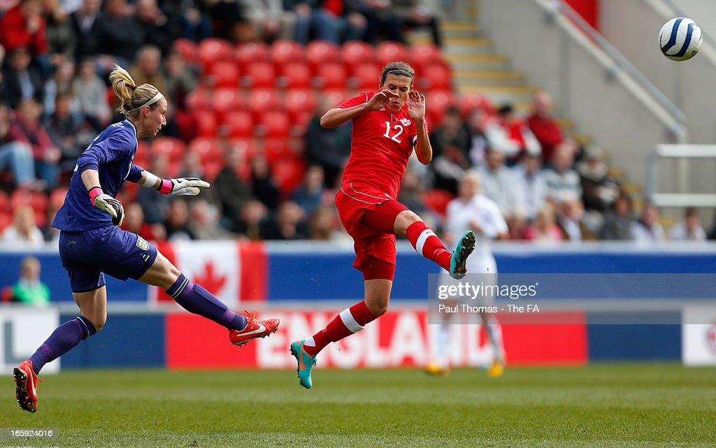 <a gi-track='captionPersonalityLinkClicked' href=/galleries/search?phrase=Karen+Bardsley&family=editorial&specificpeople=5988222 ng-click='$event.stopPropagation()'>Karen Bardsley</a> of England in action with <a gi-track='captionPersonalityLinkClicked' href=/galleries/search?phrase=Christine+Sinclair&family=editorial&specificpeople=755138 ng-click='$event.stopPropagation()'>Christine Sinclair</a> (R) of Canada during the International friendly match between England and Canada at The New York Stadium on April 7, 2013 in Rotherham, England.