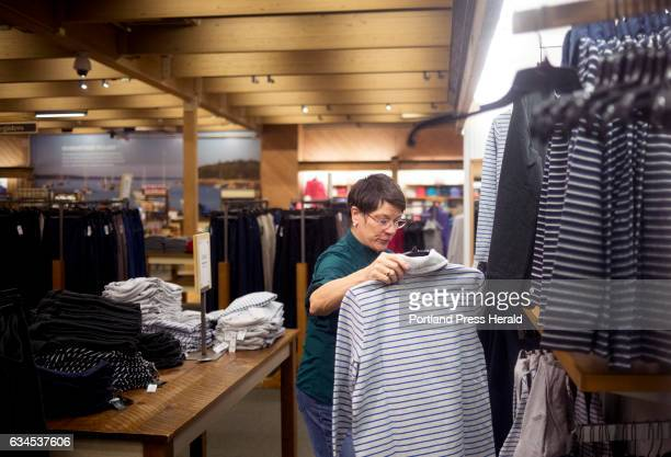 Karen Breen hangs up clothes in the women's department at the flagship LL Bean store Breen has worked for the retailer on a seasonal need basis since...