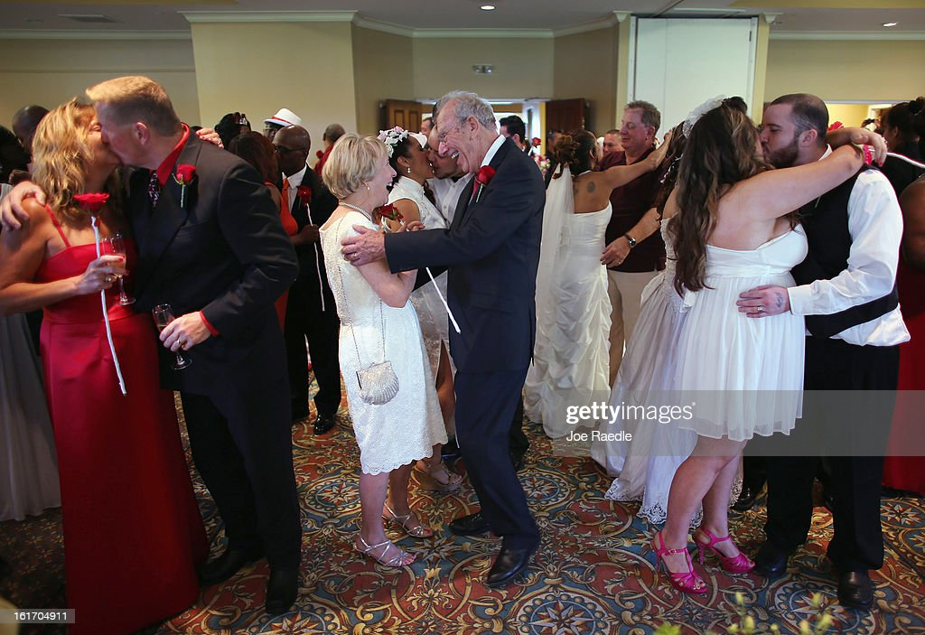 Karen Brown, Douglas Brown, Arlene Joseph, Stuart Joseph, Ashley Homa and Robert Homa all newly weds celebrate after being wed during a group Valentine's day wedding at the National Croquet Center on February 14, 2013 in West Palm Beach, Florida. The group wedding ceremony is put on by the Palm Beach Country Clerk & Comptroller's office and approximately 40 couples to tied the knot.