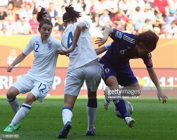 Karen Carney and Jill Scott of England fights for the ball with Mizuho Sakaguchi of Japan during the FIFA Women's World Cup 2011 group B match...