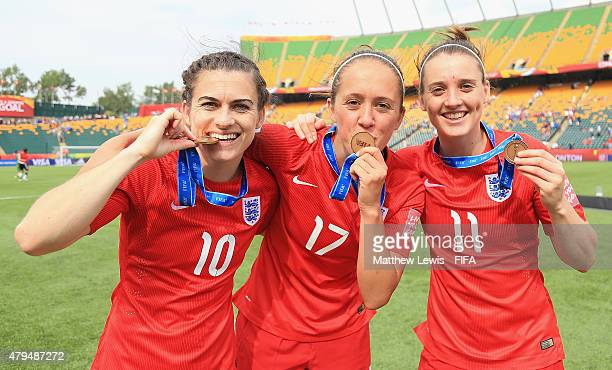 Karen Carney Jo Potter and Jade Moore of England celebrate their teams third place after defeating Germany during the FIFA Women's World Cup 2015...