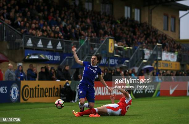 Karen Carney of Chelsea is tackled by Dominique Janssen of Arsenal during the WSL 1 match between Chelsea Ladies and Arsenal Ladies on May 17 2017 in...