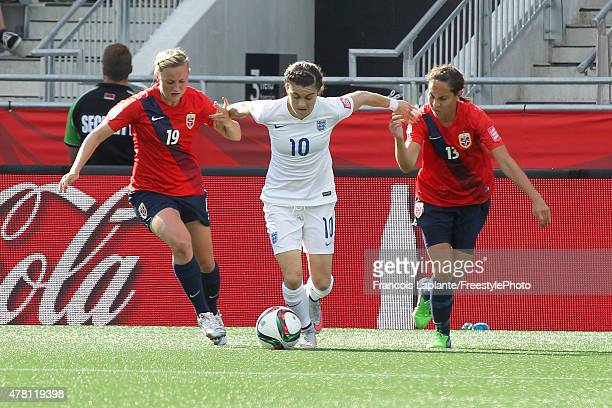 Karen Carney of England attempts to break through Kristine Minde and Ingrid Moe Wold of team Norway during the FIFA Women's World Cup Canada 2015...