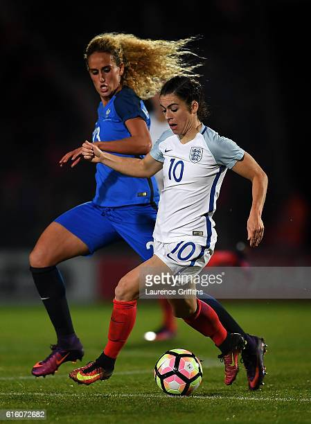 Karen Carney of England battles with Kheira Hamraoui of France during the International Friendly between England and France at Keepmoat Stadium on...