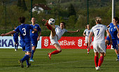 Karen Carney of England beats Antonela Radeljic of Bosnia to score the opening goal during the UEFA Women's European Championship Qualifier match...