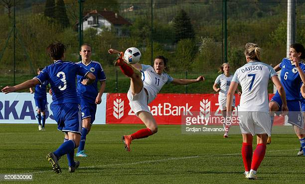 Karen Carney of England beats Antonela Radeljic of Bosnia to score the opening goal during the UEFA Women's European Championship Qualifier match...