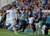 Karen Carney of England celebrates scoring during the Women's International Friendly match between England and Sweden at Victoria Park on August 3...