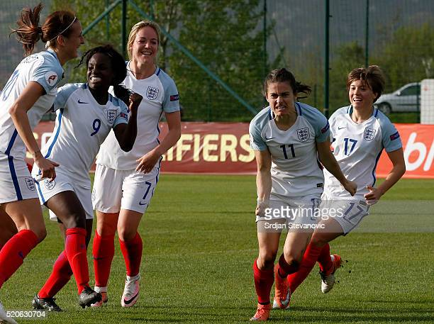 Karen Carney of England celebrates with her teammates Fran Kirby and Jill Scott Eniola Aluko and Gemma Davison after scoring the winning goal during...