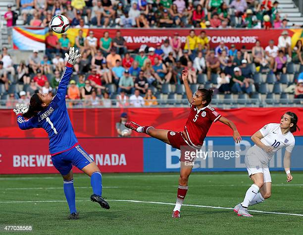Karen Carney of England gets a shot past Valeria Miranda and Cecilia Santiago of Mexico in the second half during the FIFA Women's World Cup 2015...