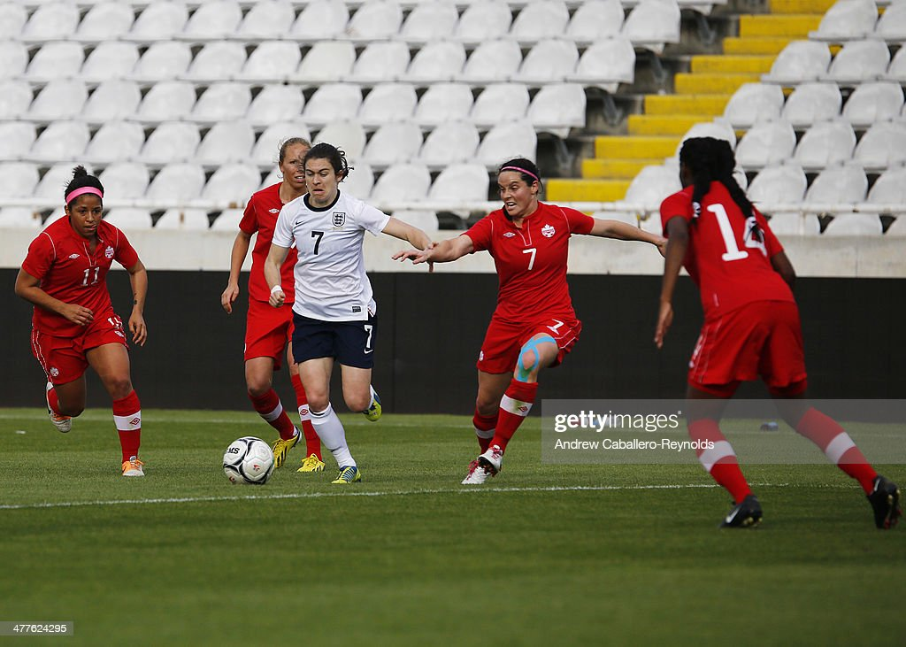 Karen Carney (C) of England in action during the Cyprus Cup match between England and Canada at GSP stadium on March 10, 2014 in Nicosia, Cyprus.