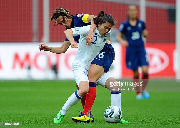 Karen Carney of England is challenged by Sandrine Soubeyrand of France during the FIFA Women's World Cup 2011 Quarter Final match between England and...