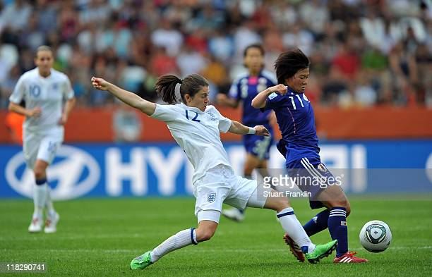 Karen Carney of England is challenged by Shinobu Ohno of Japan during the FIFA Women's World Cup 2011 group B match between England and Japan at the...