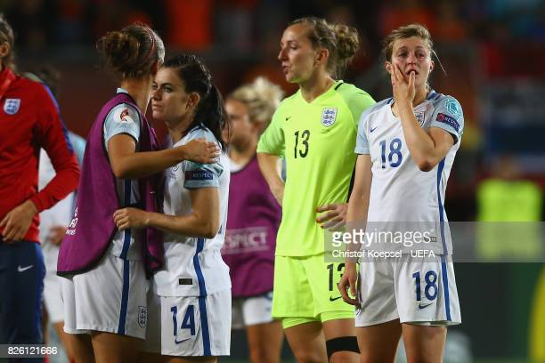 Karen Carney Siobhan Chamberlain and Ellen White of England look dejected after losing 03 the UEFA Women's Euro 2017 Second Semi Final match between...