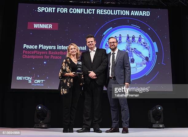 Karen Doubilet and Gareth Harper of PeacePlayers Basketball Clubs for Peace collect the Sport for Conflict Resolution award presented by Martin...